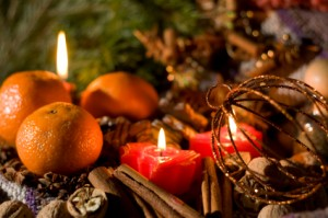 Christmas still-life - candles, mandarines, cookies, cones, nuts and spices. Low DOF, copy space on top.